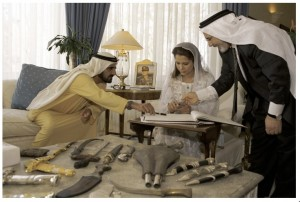 Princess Haya Bint Al Hussein and her husband sign their marriage contract. (Stolen from her website.)